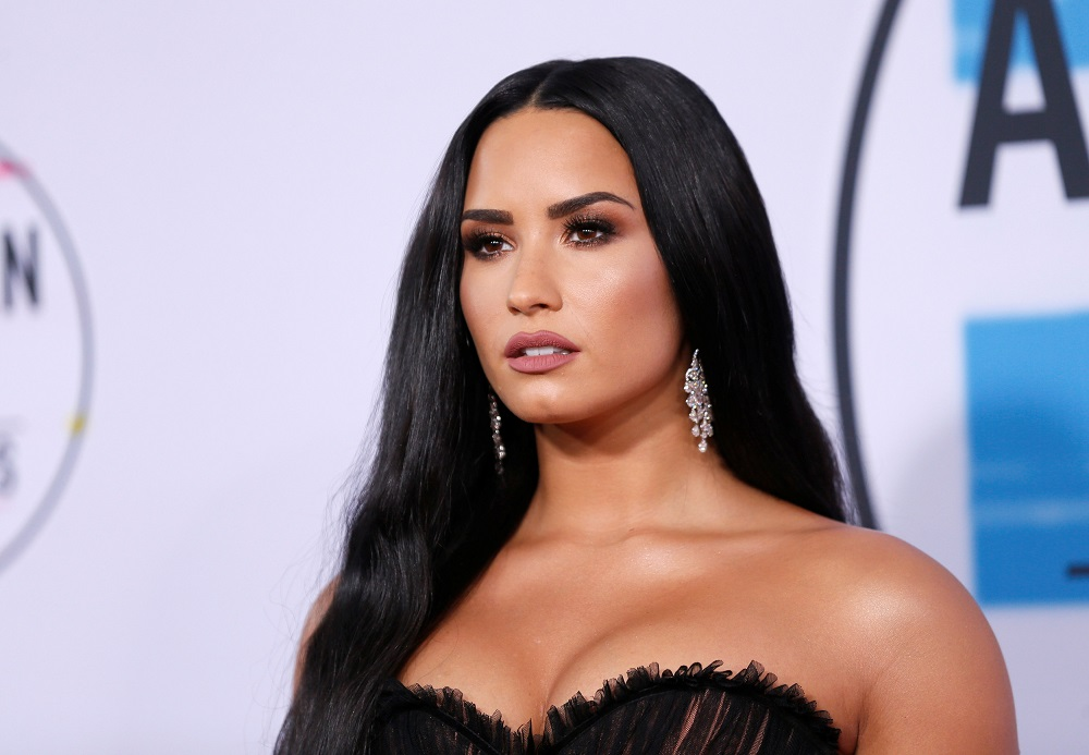 Demi Lovato describes the rocky connection with her father