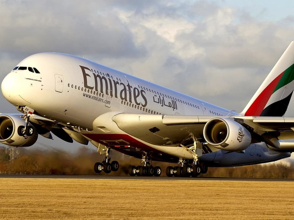 Emirates reports a $5.5 billion annual loss for first time in 30 years.