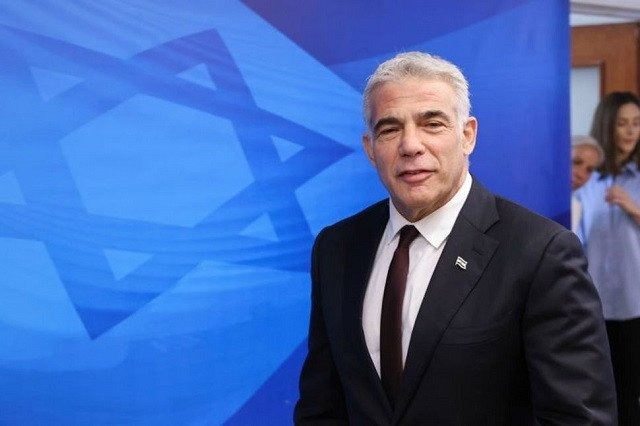 Israeli alternate Prime Minister and Foreign Minister Yair Lapid arrives to attend the first weekly cabinet meeting of the new government in Jerusalem June 20, 2021. PHOTO: REUTERS