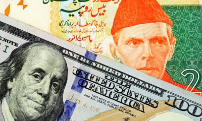pakistani-rupee-with-an-american-one-hundred-dollar