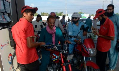 people-wait-to-fill-their-vehicles-tanks-with-petrol